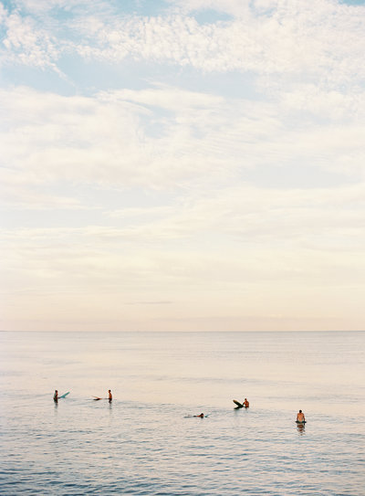 film photograph of surfers at sunset