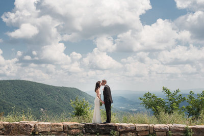 bride and groom kissing in Shenandoah National Park wedding day
