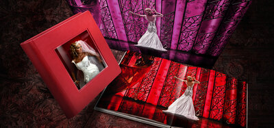 Styled photo that showcase a  red leather album with a crystal glance insert cover.
