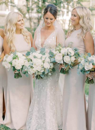 Bride with her Bridesmaids and bouquets