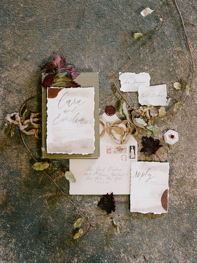 wedding invitation with earthy watercolor tones and abstract art for wedding at industrial warehouse in brooklyn nyc