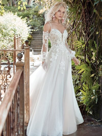 Cold Shoulder Bishop Sleeve Princess Wedding Dress. A cold-shoulder bishop sleeve princess wedding dress for A) looking like you stepped out of a Pre-Raphaelite painting, and B) happy-crying with your betrothed.