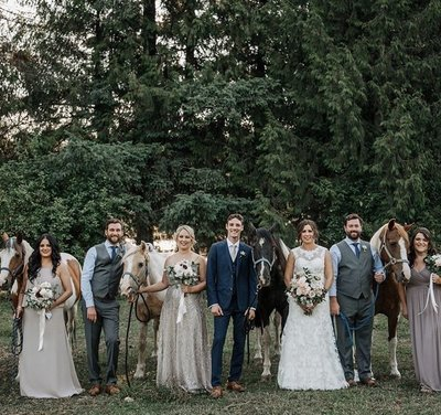 Rustic wedding bridal party and horse group photo