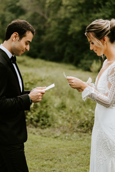 bride adeline waugh and groom read each other letters during their first look at the woodend sanctuary in bethesda maryland