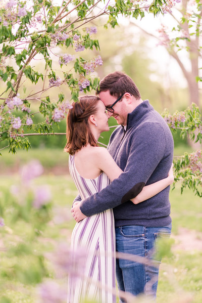 Couple laughing and interacting at Holcomb Gardens Butler University Indianapolis Indiana Engagement Photo