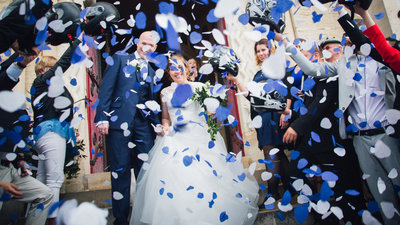 bride and groom exiting church wedding ceremony with confetti