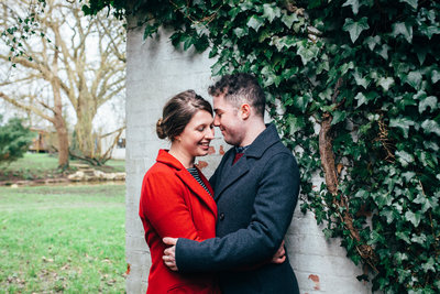 Photograph of relaxed couple laughing and cuddling outside their Suffolk home
