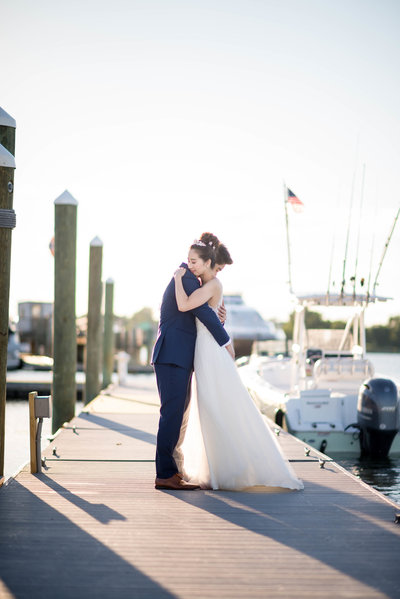 Bride and Groom embracing on dock at Venezia Boston