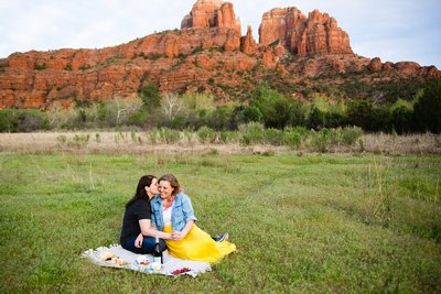 LGBT couple having a picnic during their Sedona engagement session by PMA Photography.