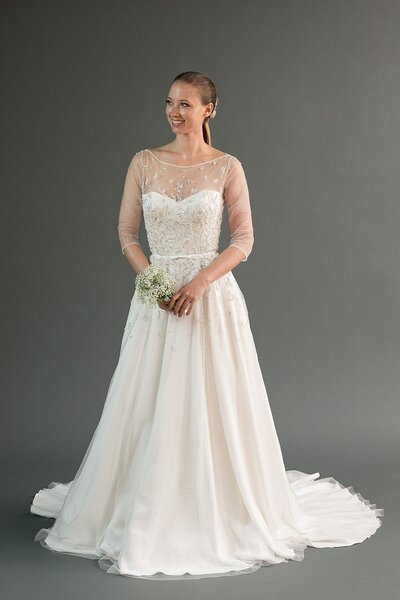 Photo link to more details about the Rei pearl beaded wedding dress