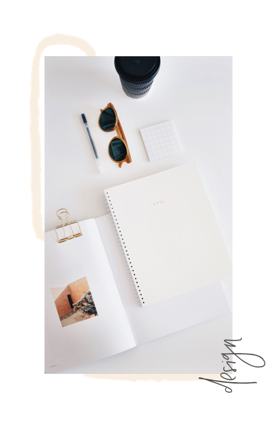 overhead view of notebook, coffee, sunglasses on desk