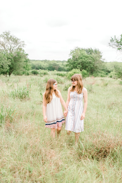 two sisters in a field