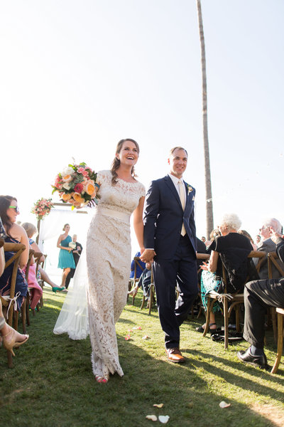 Bride and groom celebrating down the aisle at their wedding at Scripps Seaside Forum