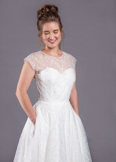Photo link to more details about the Norma Jean illusion neckline wedding dress