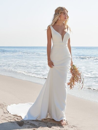 Simple Sheath Crepe Wedding Gown. How to dazzle your guests, sans the bedazzlements: opt for the enduring grace and charm of a simple sheath crepe wedding gown.