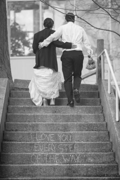 A creative message is written on the stairs for a bride and groom.