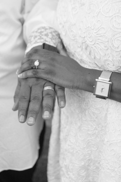 African American Woman with Wedding Ring Holding Hands with African American Man