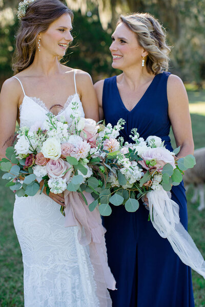 Garden bouquets with abundant gossamer silk ribbon held by an autumn bride and her Maid of Honor