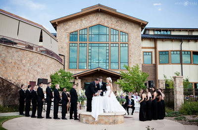 Outdoor-Ceremony-on-a-hot-sunny-day-at-Heritage-Eagle-Bend-in-Aurora-Colorado