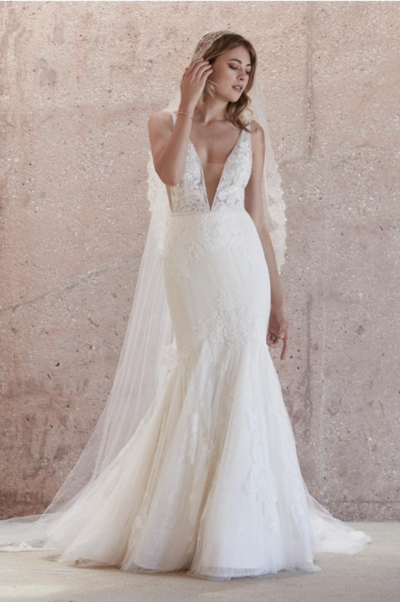 Make a statement walking in and walking out in our Campbell gown. Fashioned from crisp ivory Anjo lace and frothy layers of soft netting, we've added two laces layered one over the other for dimension and drama.