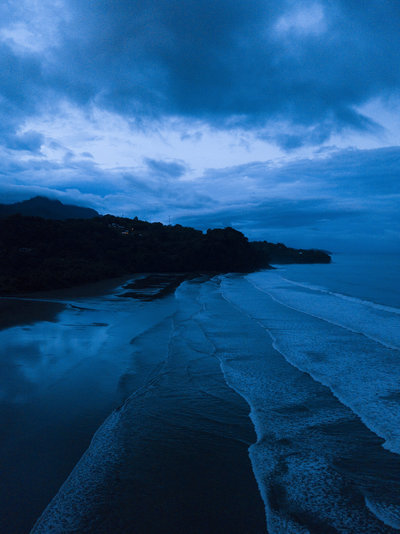 drone shot of a blue sunset on playa uvita in costa rica