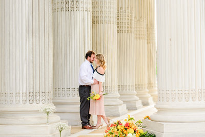Rule of thirds shot of a couple in love during their intimate sunrise engagement session with DC Wedding Photographers BSP at the DAR Constitutional Hall Building
