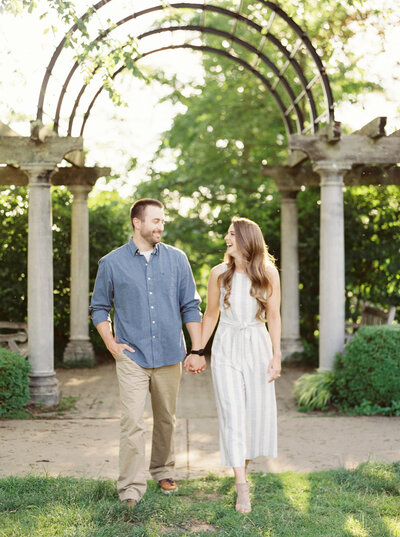 Couple walking hand in hand at their Ault Park engagement session in Cincinnati