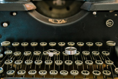 Wedding Ring Sits on Vintage Typewriter | Tucson Wedding Photographer