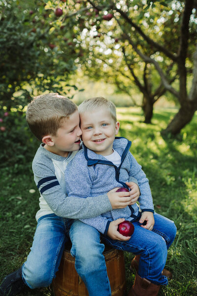 boys in apple orchard