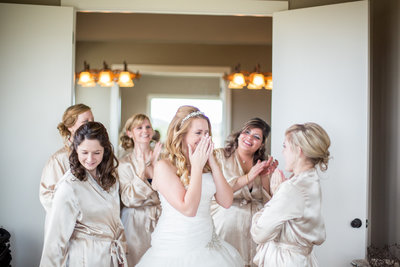 bride getting ready before wedding and crying tears of joy with bridesmaids for a picture by San Antonio Wedding Photographer