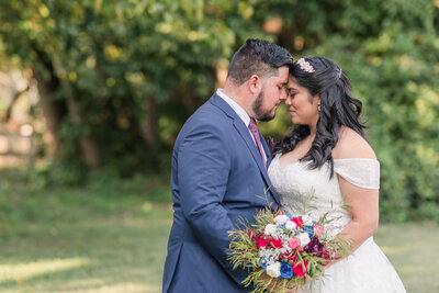 Bride and groom embrace  each other at their intimate Maryland backyard  wedding