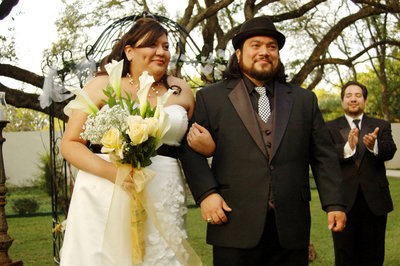 San Antonio Photographers David Castillo and Irene Castillo walking down the isle after they were married