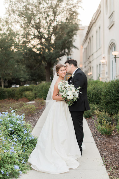 Bride and Groom Portraits with Greenery and White Floral Bouquet