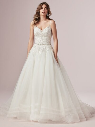 Sleeveless Ball Gown Wedding Dress. Be true to classic in a sleeveless ball gown wedding dress. Elegant lace motifs and a flattering silhouette ensure a subtle yet captivating look for your big day.