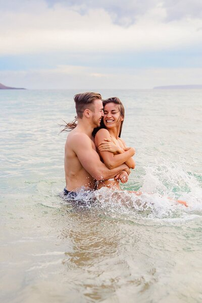 Couple splashing in the water