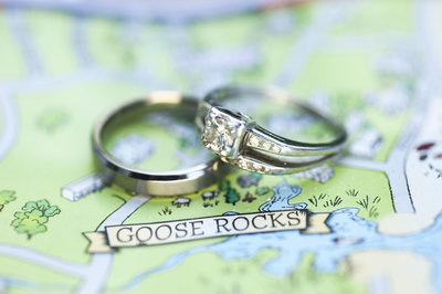 Wedding rings photographed on a map of Goose Rocks