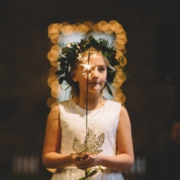 Tahoe Wedding Planners flower girl holding sparkler and wearing crown at venue Miners Foundry Cultural Center​ Nevada City, ​Joy of Life Events image by Myrtle & Marjoram Photography