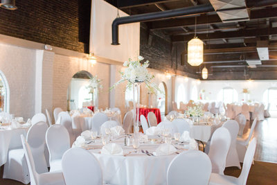 white linens and chair covers for wedding
