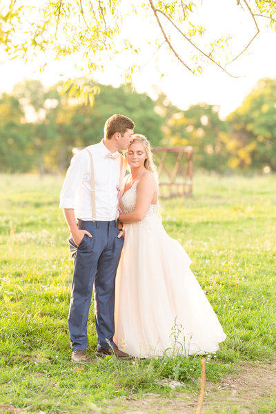 romantic portrait of wedding couple on a farm