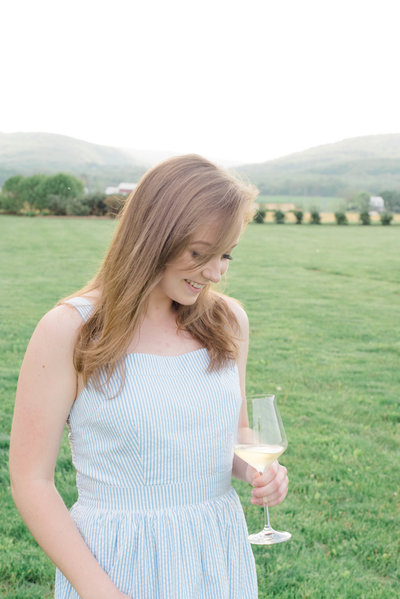 Woman at winery with glass of white wine