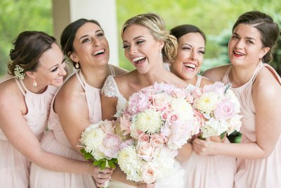Bridesmaids laughing at Hillendale Country Club wedding