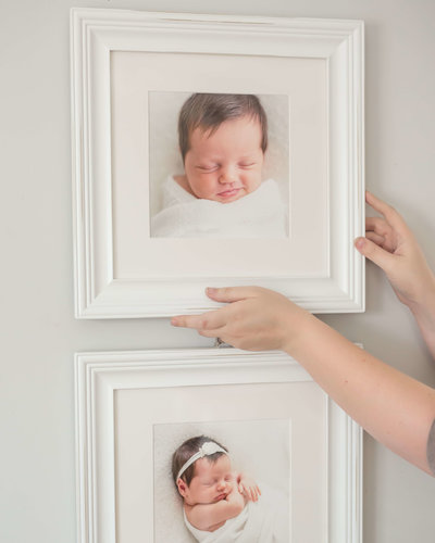 hanging framed newborn artwork in home in houston heights