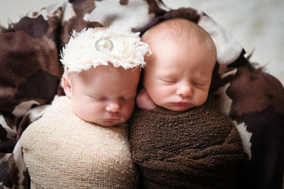 Beautiful Mississippi Newborn Photography:  Twin boy and girl snuggle and sleep