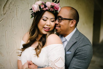 a couple with flowe crown cuddles up at the new jersey botanical gardens and skylands manor