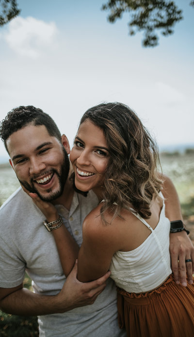 man & woman smiling