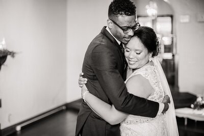 black and white photo of bride and groom hugging by Knoxville Wedding Photographer, Amanda May Photos
