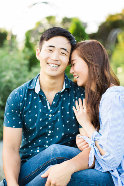young asian couple snuggling and laughing