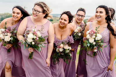 Bridesmaids watching bride come down aisle