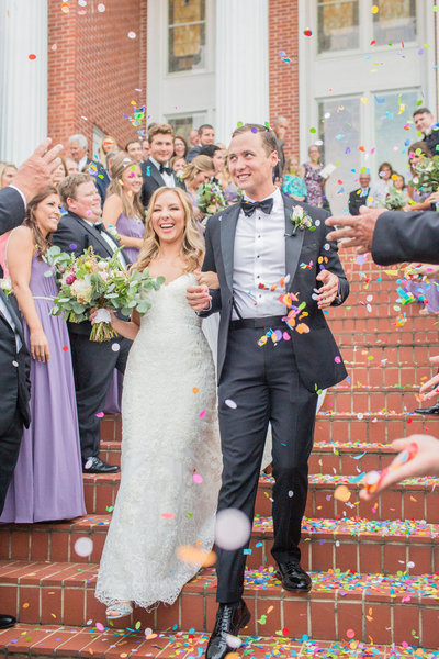Bride and Groom confetti toss after ceremony at Mississippi Wedding