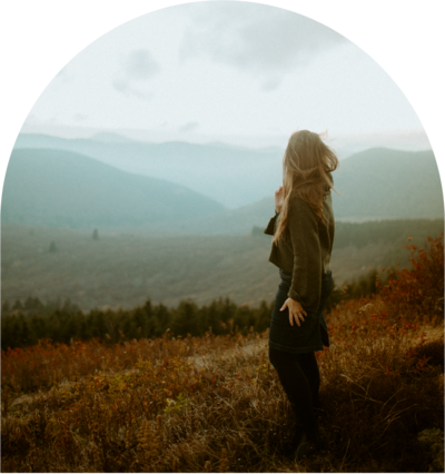 woman looking out at the mountain landscape